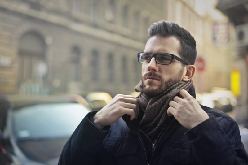 Man with glasses with pompadour style hair